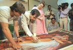Dilip Kumar walks down the memory lane as he shows a Mughal-e-Azam poster to Saira Bano and Shahrukh
