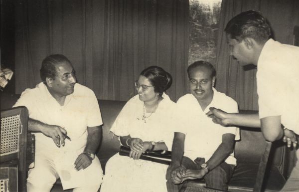 Mohd Rafi discussing with Hari Prasad Chaurasia and others in the recording studio