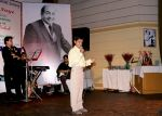 19(300708)-A young artist performing Rafi Sahab's song.jpg