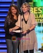 Singer Miley Cyrus, Taylor Swift  onstage at the 51st Annual GRAMMY Awards held at the Staples Center on February 8, 2009 in Los Angeles, California.jpg